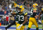 Green Bay Packers' Aaron Jones (33) celebrates his touchdown against the Dallas Cowboys during the second half of an NFL football game in Arlington, Texas, Sunday, Oct. 6, 2019. (AP Photo/Michael Ainsworth)