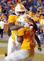Tennessee running back Eric Gray (3) is congratulated by Marquez Callaway after scoring a touchdown in the second half of an NCAA college football game against Vanderbilt, Saturday, Nov. 30, 2019, in Knoxville, Tenn. (AP Photo/Wade Payne)