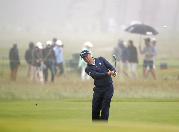 Justin Thomas hits off the eighth fairway during a practice round for the U.S. Open Golf Championship, Wednesday, June 13, 2018, in Southampton, N.Y. (AP Photo/Julio Cortez)