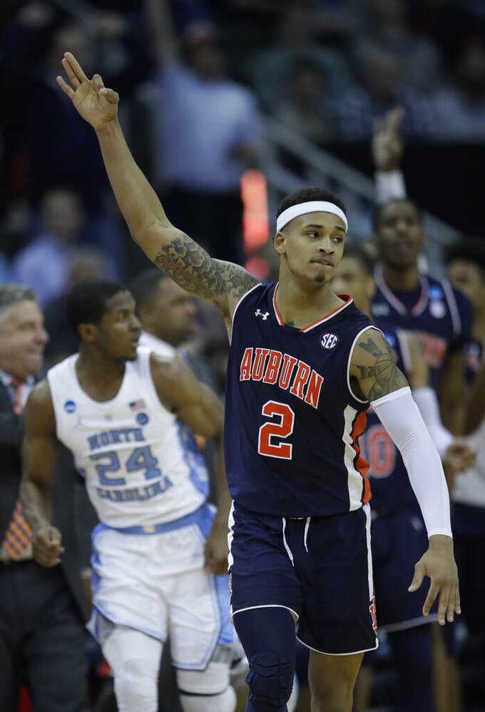 Auburn's Bryce Brown celebrates after making a 3-point basket during the second half of a men's NCAA tournament college basketball Midwest Regional semifinal game against North Carolina Friday, March 29, 2019, in Kansas City, Mo. (AP Photo/Orlin Wagner)