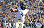 Vanderbilt running back Ke'Shawn Vaughn celebrates as he runs into the end zone after catching a pass for a touchdown during the first half of an NCAA college football game against Missouri Saturday, Nov. 10, 2018, in Columbia, Mo. (AP Photo/Jeff Roberson)
