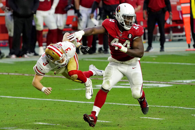 Arizona Cardinals' Markus Golden (44) shoves San Francisco 49ers quarterback C.J. Beathard (3) after the pass during the second half of an NFL football game, Saturday, Dec. 26, 2020, in Glendale, Ariz. (AP Photo/Rick Scuteri)