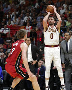 Cleveland Cavaliers forward Kevin Love (0) shoots a 3-pointer over Miami Heat forward Kelly Olynyk (9) during the first half of an NBA basketball game, Wednesday, Nov. 20, 2019, in Miami. (AP Photo/Lynne Sladky)