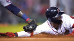 Boston Red Sox's Alex Verdugo, right, is tagged out by Minnesota Twins first baseman Miguel Sano while diving back to first after rounding the base during the fourth inning of a baseball game at Fenway Park, Wednesday, Aug. 25, 2021, in Boston. (AP Photo/Charles Krupa)