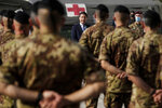 Italian Prime Minister Giuseppe Conte, center, addresses Italian soldiers as he visits an Italian field hospital set up at the Lebanese University in the Hadath district of Beirut, Lebanon, Tuesday, Sept. 8, 2020. Conte said Tuesday his country will support Lebanon's economic and social growth, expressing hopes that a new government is formed quickly — one that would start the reconstruction process in the wake of last month's Beirut explosion and implement badly needed reforms. (AP Photo/Hassan Ammar)