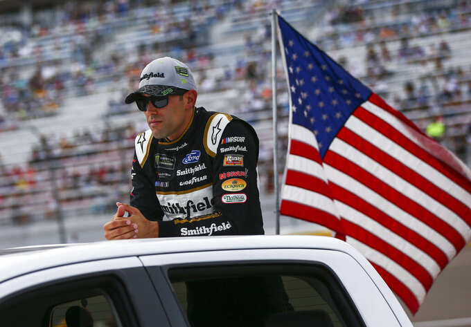 Aric Almirola looks on before a NASCAR Cup Series auto race at the Las Vegas Motor Speedway on Sunday, Sept. 15, 2019. (AP Photo/Chase Stevens)