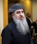 Mullah Krekar in a District Court in Oslo, Norway, Wednesday July 17, 2019. Norway's controversial refugee, Mullah Krekar, was seized Tuesday by the Norwegian police intelligence agency PST and held on the request of Italian authorities, after an Italian court sentenced him to 12-years in prison for planning terrorist acts. (Carina Johansen / NTB Scanpix via AP)