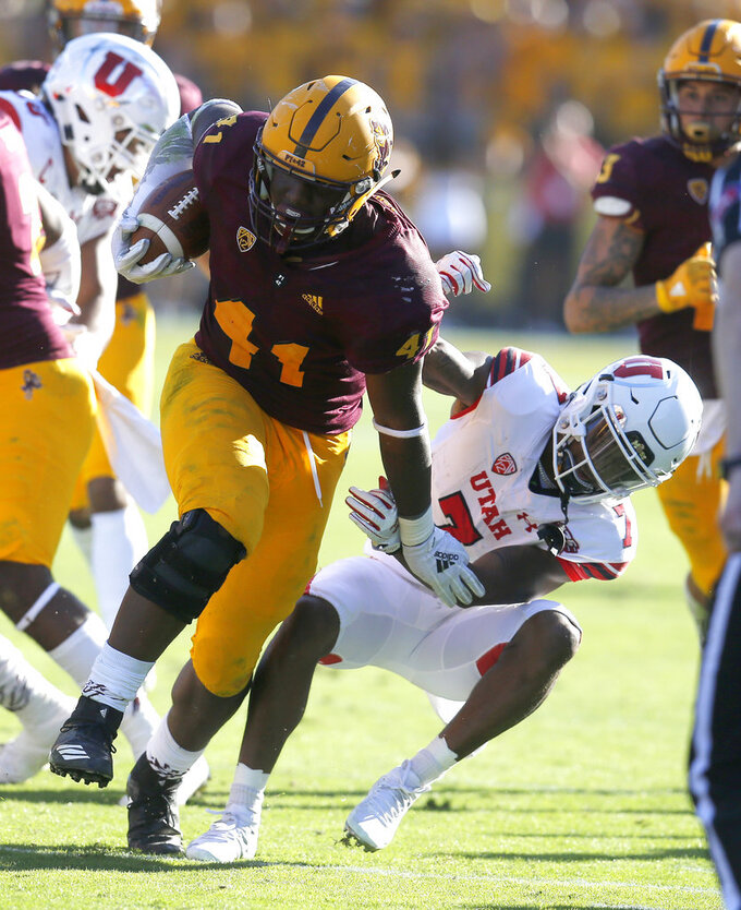 Arizona State defensive lineman Tyler Johnson (41) is tackled by Utah wide receiver Demari Simpkins after recovering a fumble in the second half during an NCAA college football game, Saturday, Nov. 3, 2018, in Tempe, Ariz. (AP Photo/Rick Scuteri)