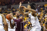 Texas A&M guard Savion Flagg, left, shoots over Missouri forward Mitchell Smith, right, during the first half of an NCAA college basketball game Tuesday, Jan. 21, 2020, in Columbia, Mo. (AP Photo/L.G. Patterson)