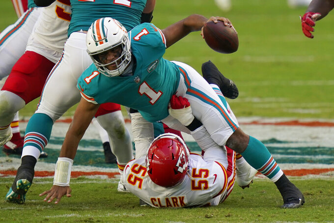 Kansas City Chiefs defensive end Frank Clark (55) sacks Miami Dolphins quarterback Tua Tagovailoa (1), during the first half of an NFL football game, Sunday, Dec. 13, 2020, in Miami Gardens, Fla. (AP Photo/Lynne Sladky)