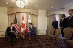 Canada's Prime Minister Justin Trudeau, center, meets with California Lt. Gov. Gavin Newsom, left, in San Francisco, Friday, Feb. 9, 2018. (AP Photo/Jeff Chiu, Pool)