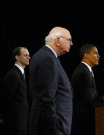 FILE - In this Nov. 26, 2008, file photo President-elect Barack Obama, right, stands with former Federal Reserve Chairman Paul Volcker, chairman-designate of the Economic Recovery Advisory Board, center, and chief economist-designate Austan Goolsbee, left, as he speaks at a news conference in Chicago. Volcker, the former Federal Reserve chairman died on Sunday, Dec. 8, 2019, according to his office, He was 92. (AP Photo/Pablo Martinez Monsivais, File)