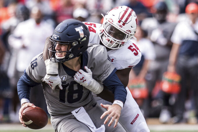 Illinois quarterback Brandon Peters (18) is sacked by Wisconsin's Chris Orr (54) in the second half of an NCAA college football game, Saturday, Oct.19, 2019, in Champaign, Ill. (AP Photo/Holly Hart)