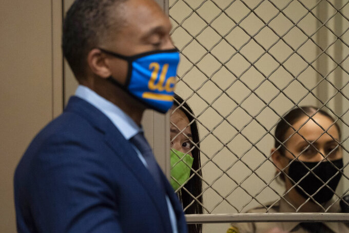 Sodsai Dalzell, center, listens to her attorney, Ayinde Jones, during her arraignment hearing Tuesday, Sept. 29, 2020, in the Van Nuys section of Los Angeles. Dalzell is charged with attempted kidnapping of Hall of Fame quarterback Joe Montana's granddaughter. (AP Photo/Jae C. Hong, Pool)