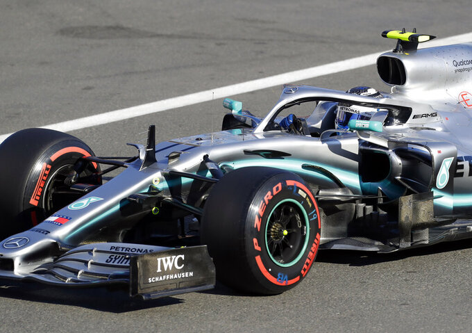 Mercedes driver Valtteri Bottas of Finland steers his car during qualifying session at the Baku Formula One city circuit in Baku, Azerbaijan, Saturday, April 27, 2019. The Azerbaijan F1 Grand Prix race will be held on Sunday. (AP Photo/Sergei Grits)