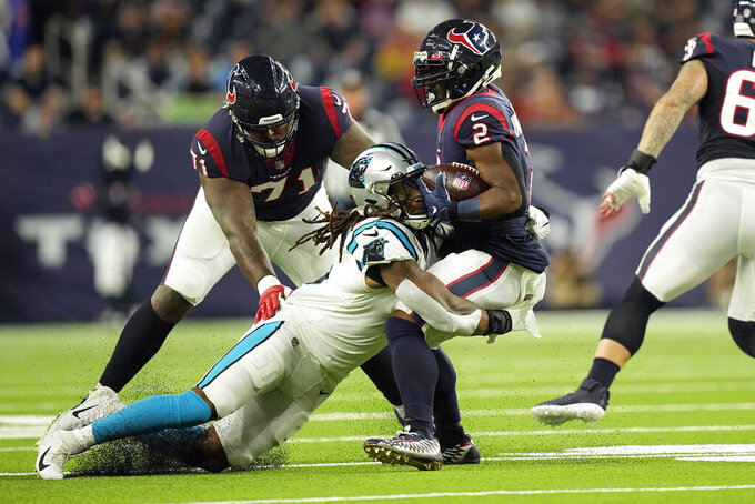 Houston Texans running back Mark Ingram II (2) is tackled by Carolina Panthers linebacker Shaq Thompson during the first half of an NFL football game Thursday, Sept. 23, 2021, in Houston. (AP Photo/Eric Christian Smith)