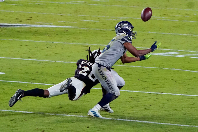 Arizona Cardinals cornerback Dre Kirkpatrick (20) breaks up a pass intended for Seattle Seahawks wide receiver Tyler Lockett during the second half of an NFL football game, Sunday, Oct. 25, 2020, in Glendale, Ariz. (AP Photo/Rick Scuteri)