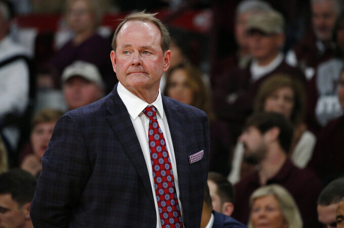 In this Jan. 12, 2019, photo, Mississippi basketball coach Kermit Davis oversees floor action in a NCAA college basketball game against in-state rival, Mississippi State, in Starkville, Miss. The coaching comeback of Davis is a tale three decades in the making and as Mississippi's first-year coach has the Rebels back in the AP Top 25 for the first time since 2013. (AP Photo/Rogelio V. Solis)