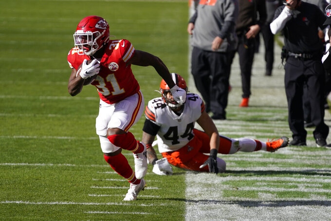 Kansas City Chiefs running back Darrel Williams (31) runs from Cleveland Browns linebacker Sione Takitaki (44) during the first half of an NFL divisional round football game, Sunday, Jan. 17, 2021, in Kansas City. (AP Photo/Jeff Roberson)