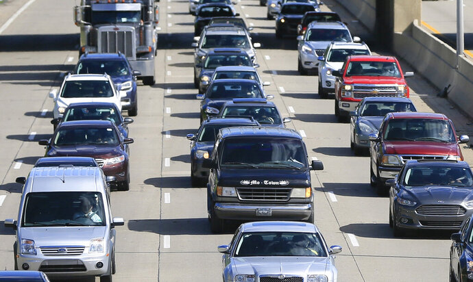 FILE- In a June 23, 2015, file photo, traffic heads north along the Lodge freeway in Detroit. Michigan drivers will have choices to make when they renew or buy a new auto insurance policy under a law taking effect Thursday, July 2, 2020. Motorist can buy unlimited personal injury protection, but it will no longer be mandatory. (AP Photo/Carlos Osorio, File)
