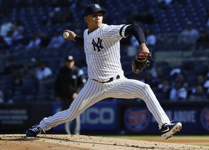 New York Yankees' Jonathan Loaisiga delivers a pitch during the second inning of a baseball game against the Detroit Tigers Wednesday, April 3, 2019, in New York. (AP Photo/Frank Franklin II)