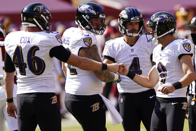 Baltimore Ravens kicker Justin Tucker (9) celebrates a point after against the Washington Football Team during the first half of an NFL football game, Sunday, Oct. 4, 2020, in Landover, Md. (AP Photo/Susan Walsh)