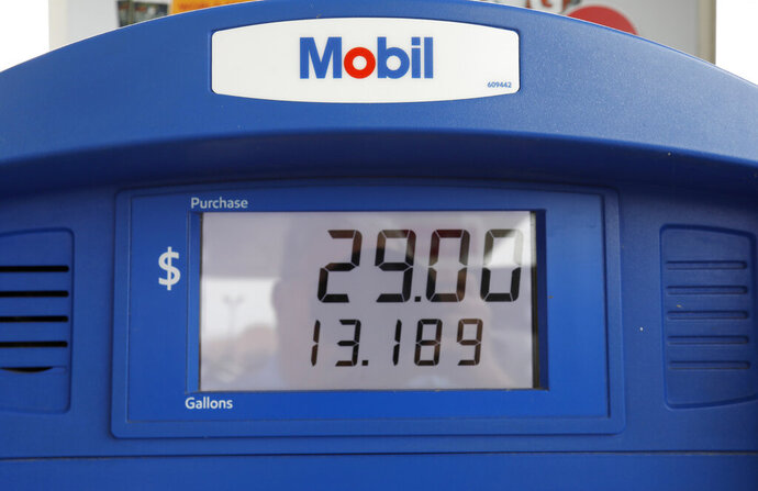 FILE - In this June 26, 2019, file photo a Mobil gas pump displays the various types of fuel and their prices at this Flowood, Miss., station. Exxon Mobil Corp. reports financial results Friday, Nov. 1. (AP Photo/Rogelio V. Solis, File)