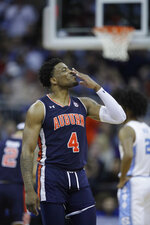 Auburn's Malik Dunbar celebrates during the second half of a men's NCAA tournament college basketball Midwest Regional semifinal game against North Carolina Friday, March 29, 2019, in Kansas City, Mo. (AP Photo/Orlin Wagner)