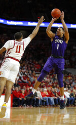 TCU guard Desmond Bane, right, shoots over Iowa State guard Talen Horton-Tucker, left, during the first half of an NCAA college basketball game, Saturday, Feb. 9, 2019, in Ames. (AP Photo/Matthew Putney)