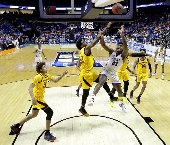 Buffalo's Nick Perkins (33) puts up a shot under pressure from Arizona Sate's De'Quon Lake during the first half of a first round men's college basketball game in the NCAA Tournament Friday, March 22, 2019, in Tulsa, Okla. (AP Photo/Charlie Riedel)