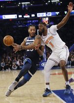 Minnesota Timberwolves' Derrick Rose (25) drives past New York Knicks' Emmanuel Mudiay (1) during the first half of an NBA basketball game Friday, Feb. 22, 2019, in New York. The Timberwolves won 115-104. (AP Photo/Frank Franklin II)
