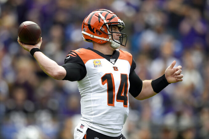 Cincinnati Bengals quarterback Andy Dalton throws a pass against the Baltimore Ravens during the first half of a NFL football game Sunday, Oct. 13, 2019, in Baltimore. (AP Photo/Gail Burton)