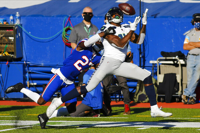 Seattle Seahawks' DK Metcalf (14) catches a pass in front of Buffalo Bills' Tre'Davious White (27) during the first half of an NFL football game Sunday, Nov. 8, 2020, in Orchard Park, N.Y. (AP Photo/Jeffrey T. Barnes)