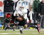 Tulane wide receiver Terren Encalade (5) loses the reception under pressure from Houston cornerback Isaiah Johnson (14) during the first half of an NCAA college football game Thursday, Nov. 15, 2018, in Houston. (Michael Wyke/Houston Chronicle via AP)