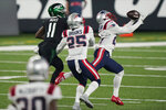 New England Patriots' J.C. Jackson, right, intercepts a pass intended for New York Jets' Denzel Mims (11), left, during the second half of an NFL football game, Monday, Nov. 9, 2020, in East Rutherford, N.J. (AP Photo/Corey Sipkin)