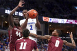 Memphis' Alex Lomax (2) gets a rebound as Little Rock's Ben Coupet Jr. (0) and Ruot Monyyong (44) defend during the second half of an NCAA college basketball game Wednesday, Nov. 20, 2019, in Memphis, Tenn. (AP Photo/Karen Pulfer Focht)