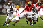 Maryland running back Tayon Fleet-Davis (8) runs with the ball against Howard defensive back Carson Hinton (4) during the first half of an NCAA college football game, Saturday, Sept. 11, 2021, in College Park, Md. (AP Photo/Nick Wass)