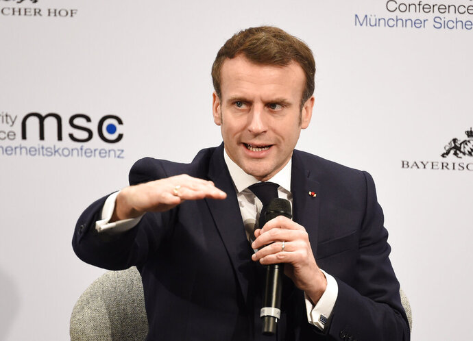 French President Emmanuel Macron gestures on the second day of the Munich Security Conference in Munich, Germany, Saturday, Feb. 15, 2020. (AP Photo/Jens Meyer)