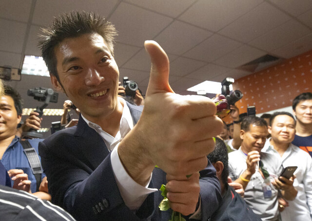 Thailand's Future Forward Party leader Thanathorn Juangroongruangkit gestures to supporters at the party's headquarters in Bangkok, Thailand, Tuesday, Jan. 21, 2020. Thailand's Constitutional Court acquitted the country's third-biggest political party of seeking the overthrow of the country's constitutional monarchy. The court ruled Tuesday that the Future Forward Party showed no intention of committing the offense, and that the complaint had not been filed according to the correct legal procedure. (AP Photo/Sakchai Lalit)