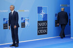 President Donald Trump, right, walks away after being greeted by NATO Secretary General Jens Stoltenberg, left, before a summit of heads of state and government at NATO headquarters in Brussels on Wednesday, July 11, 2018. NATO leaders gather in Brussels for a two-day summit to discuss Russia, Iraq and their mission in Afghanistan. (AP Photo/Pablo Martinez Monsivais)