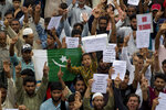 Kashmiri Muslims hold placards and shout pro-freedom slogans during a demonstration after Friday prayers amid curfew like restrictions in Srinagar, India, Friday, Aug. 16, 2019. Hundreds of Kashmiris held a street protest in the Indian-controlled Kashmir even as India's government assured the Supreme Court on Friday that the situation in disputed Kashmir is being reviewed daily and unprecedented security restrictions will be removed over the next few days, an attorney said after the court heard challenges to India's moves. (AP Photo/Dar Yasin)