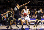 Notre Dame's Nikola Djogo (13) drives in under pressure from Wake Forest's Olivier Sarr (30) during the second half of an NCAA college basketball game Wednesday, Jan. 29, 2020, in South Bend, Ind. Notre Dame won 90-80. (AP Photo/Robert Franklin)