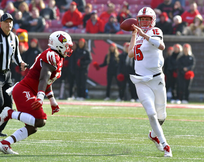 North Carolina State quarterback Ryan Finley (15) attempts a pass while under pressure from Louisville defensive end Amonte Caban (53) during the second half of an NCAA college football game, in Louisville, Ky., Saturday, Nov. 17, 2018. North Carolina State won 52-10. (AP Photo/Timothy D. Easley)