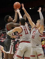 Washington State forward Robert Franks, left, shoots against Stanford forward Jaiden Delaire (11) and forward Lukas Kisunas (32) during the second half of an NCAA college basketball game in Stanford, Calif., Thursday, Feb. 28, 2019. (AP Photo/Jeff Chiu)