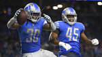 Detroit Lions running back Jamaal Williams (30) celebrates his touchdown run with Jason Cabinda (45) in the second half of an NFL football game against the San Francisco 49ers in Detroit, Sunday, Sept. 12, 2021. (AP Photo/Lon Horwedel)