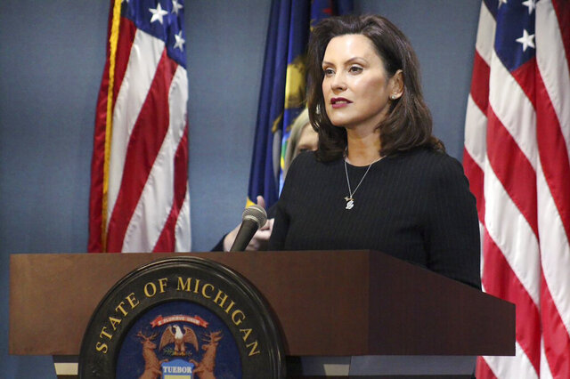 This photo provided by the Michigan Office of the Governor, Michigan Gov. Gretchen Whitmer addresses the state during a speech in Lansing, Mich., Wednesday, April 29, 2020. The governor on Wednesday proposed free college for health care workers and others involved in the coronavirus fight, likening their service during the pandemic to soldiers who got a free education after returning home from World War II. (Michigan Office of the Governor via AP, Pool)