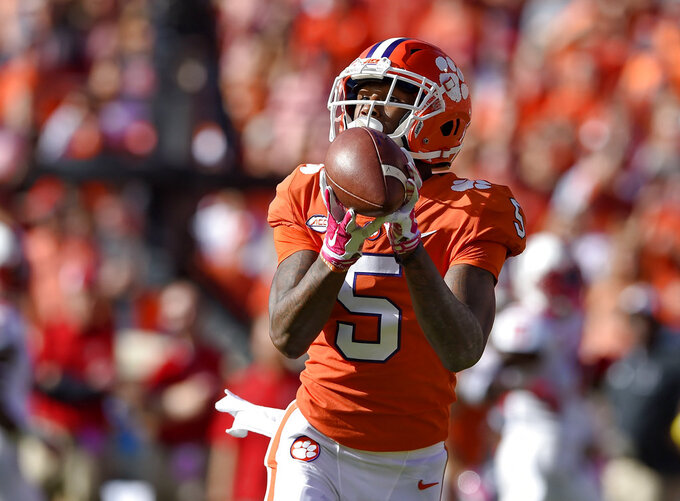 Clemson's Tee Higgins catches a pass for a touchdown during the first half of an NCAA college football game against North Carolina State, Saturday, Oct. 20, 2018, in Clemson, S.C. (AP Photo/Richard Shiro)