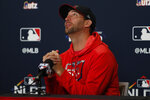 St. Louis Cardinals starting pitcher Adam Wainwright responds to a question during a news conference at the baseball National League Division Series Saturday, Oct. 5, 2019, in St. Louis. Wainwright is expected to start when the Cardinals play Game 3 of the series against the Atlanta Braves on Sunday in St. Louis. (AP Photo/Jeff Roberson)
