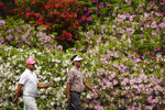 Brooks Koepka and Bubba Watson, right, walk down to the sixth green during the second round of the Masters golf tournament on Friday, April 9, 2021, in Augusta, Ga. (AP Photo/Matt Slocum)