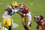 Green Bay Packers wide receiver Davante Adams (17) runs against San Francisco 49ers linebacker Azeez Al-Shaair (51) and cornerback Jason Verrett (22) during the first half of an NFL football game in Santa Clara, Calif., Thursday, Nov. 5, 2020. (AP Photo/Jed Jacobsohn)